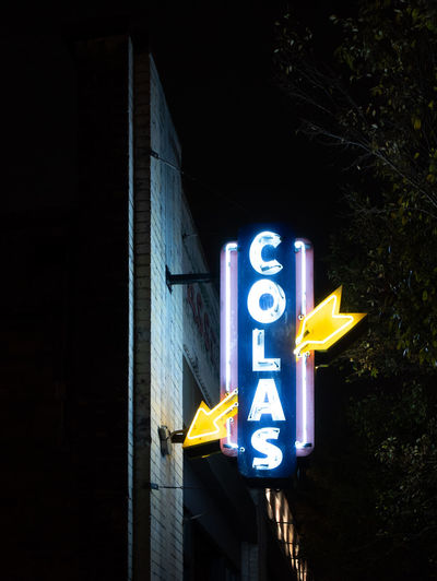 favourite columbia places at night Illuminated Night Neon No People Low Angle View Architecture Yellow Built Structure Sign Communication Glowing Building Exterior Outdoors Lighting Equipment Dark Text Shape
