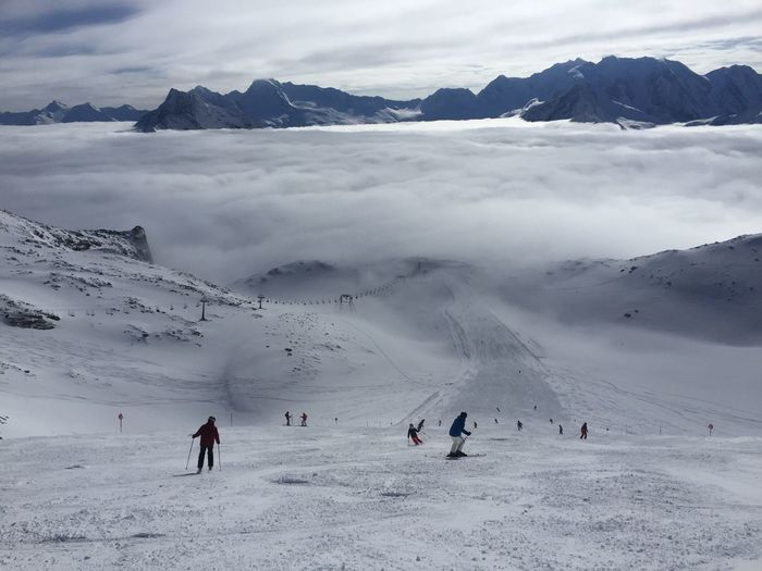 Panoramic view of people skiing on snowcapped mountain