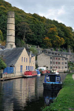 boats and building in hebden bridge uk Hebden Bridge Architecture Beauty In Nature Boats Building Exterior Built Structure Canal Cloud - Sky Day Mode Of Transport Moored Nature Nautical Vessel No People Outdoors River Sky Town Transportation Travel Destinations Tree Water Waterfront