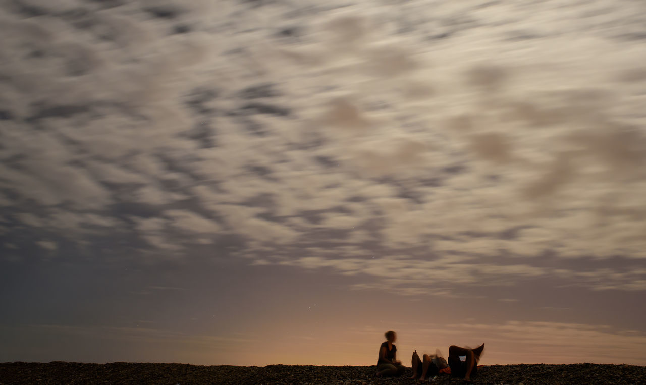 sunset, sky, real people, cloud - sky, nature, lifestyles, beauty in nature, scenics, leisure activity, domestic animals, men, togetherness, mammal, silhouette, walking, women, landscape, outdoors, rural scene, two people, adventure, pets, friendship, day, people
