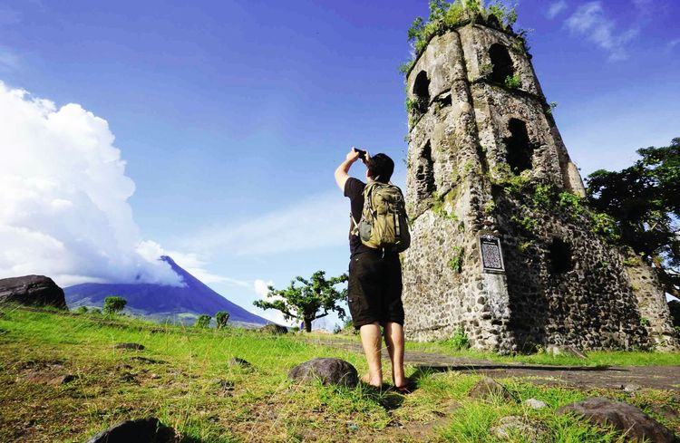 Day Outdoors One Person Sky Spraying People Adult Grass Adults Only One Man Only Water Only Men Blue Full Length Vacations Standing Nature Young Adult Mayon Volcano Daraga, Albay Philippines Albay, Philippines Historical Monuments Inner Power The Great Outdoors - 2018 EyeEm Awards The Traveler - 2018 EyeEm Awards