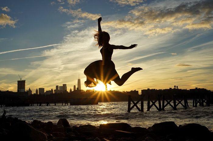 Sunset Silhouette Jumping Sun Achievement Celebrate Sunlight Mid-air Jump Woman