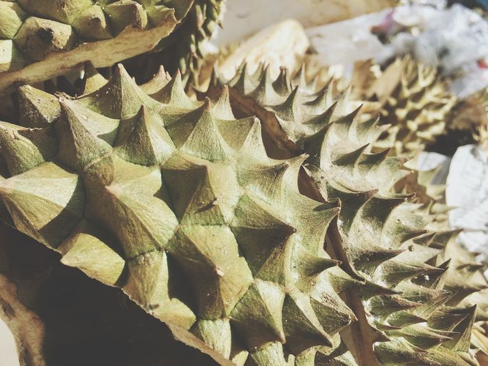 Durian peel on garbage heap in Thailand Market. Durian Outdoors Close-up Green Thorn Prickle Barb Spine Smile Asia Fruit