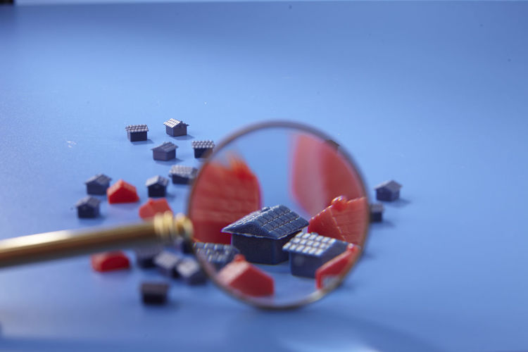 magnifying glass on miniature house Enlarge Toys Blue Blue Background Buying Close-up Colored Background Copy Space Focus House Housing Indoors  Investment Large Group Of Objects Location Magnifying Glass Mini No People Owner Property Real Estate Searching Selective Focus Still Life Studio Shot