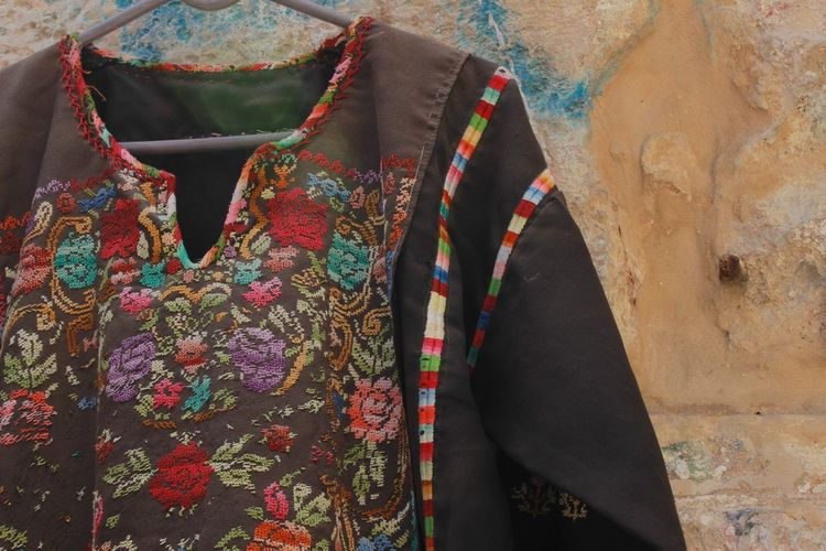 Close-Up Of Colorful Floral Pattern Womenswear On Wall