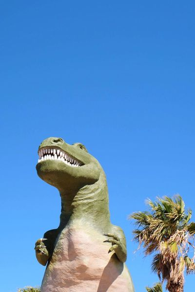 World famous Cabazon Dinosaur Dinosaur Statue Low Angle View Clear Sky Blue Day Sculpture Outdoors Animal Themes California Dreamin