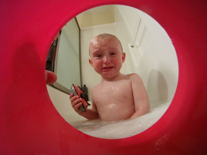 Bath Bath Time Bath Tub Bathtime Bathtoys Bathtub Boy Boys Bucket Child Childhood Cry Crying Crying Child Framed Front View Indoors  Looking At Camera Looking Out Parenthood Parenting Person Portrait Red Tears