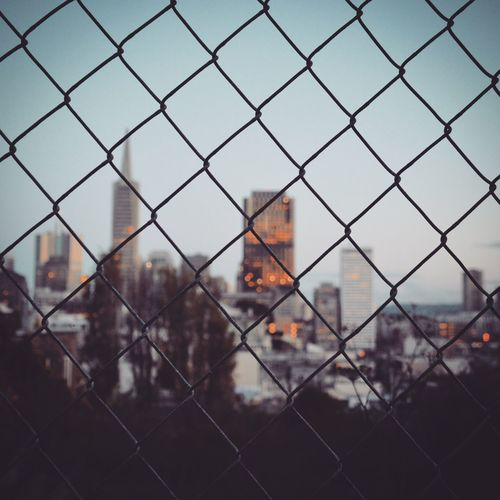 City Protection Safety Fence Chainlink Fence Security Focus On Foreground Full Frame Close-up City Sky Day Chain Link Fence No People