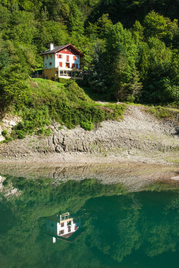 Chalet on the lake, near the Kakuetta gorge, Pyrénées Chalet Exploring Hiking Isolated Lonely Pyrenees Quiet Tranquility Travel Adventure Architecture Beauty In Nature Building Exterior Exploration Forest Green Color House Lake Lake View Landscape Mountain Nature Naturelovers Pine Tree Water