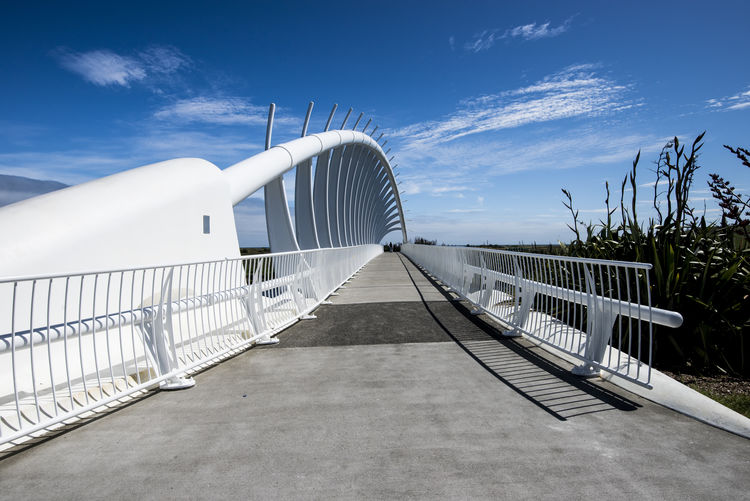 The famous Te Rewa Rewa footbridge in New Zealand Architecture Te Rewa Rewa Bridge Bridge Cycleway Diminishing Perspective Mountain Mountain Range Mt Taranaki New Plymouth No People Outdoors Railing Steel Structure  Sunlight The Way Forward Volcano White