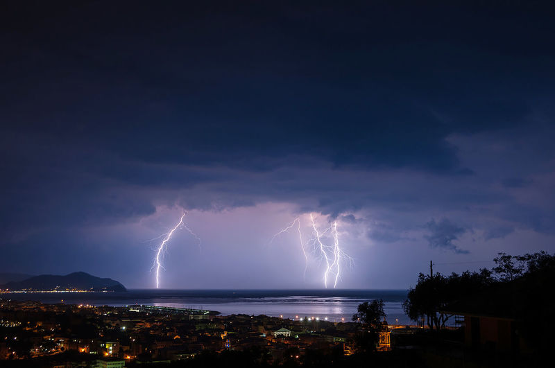 Lightening strikes town near coast at night