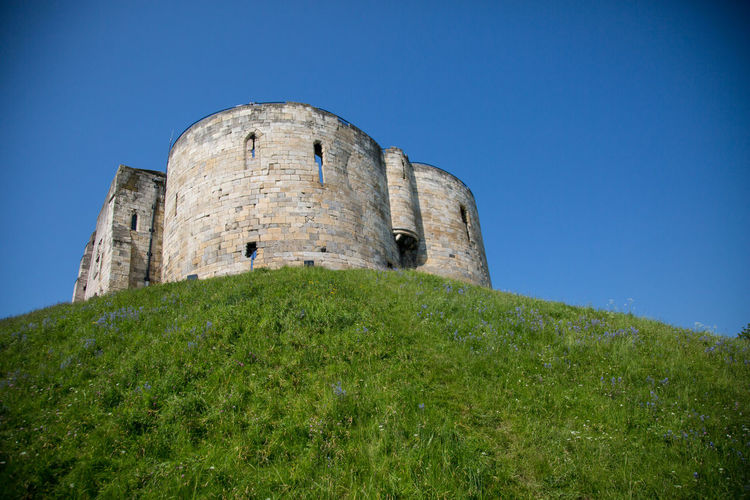 The Tower Clifford's Tower York Ancient Ancient Civilization Architecture Blue Building Building Exterior Built Structure Castle Clear Sky Day Fort Grass Green Color History Low Angle View Nature No People Outdoors Plant Ruined Sky The Past