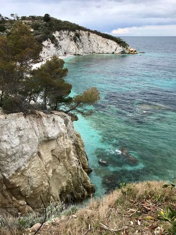 Turquoise Water Rock Sea Beauty In Nature Rock - Object Solid Scenics - Nature Tranquility Land Plant Sky Tranquil Scene Nature Day Rock Formation Beach Cliff Tree No People Outdoors