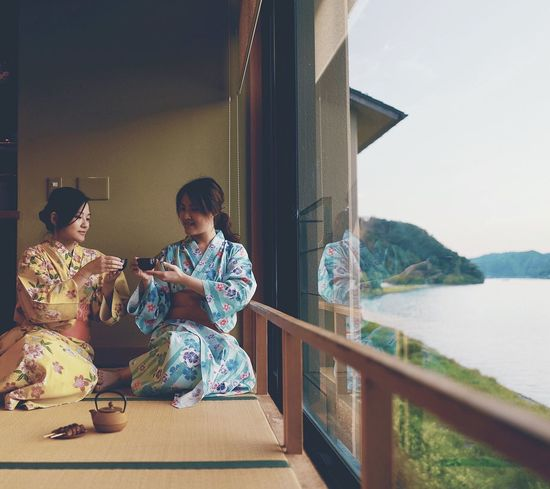 Japan Photography Casual Clothing Child Childhood Day Females Kimono Leisure Activity Lifestyles Mountain Nature People Railing Real People Sitting Togetherness Water Women Young Adult