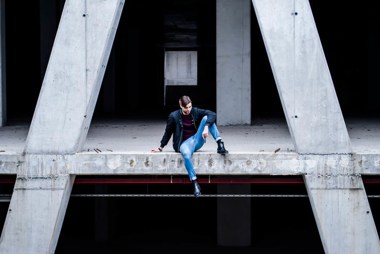 Portrait Of Man Sitting On Concrete Flooring
