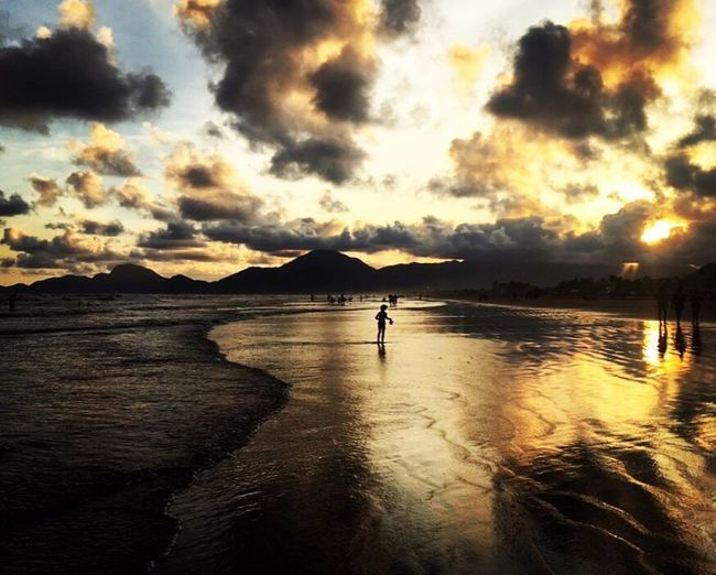EyeEmNewHere Sunset Water Sky Cloud - Sky Reflection Sea Beauty In Nature Nature Outdoors Real People Beach Vacations Full Length One Person Day People Photography Close-up Sweet Kid Inocence