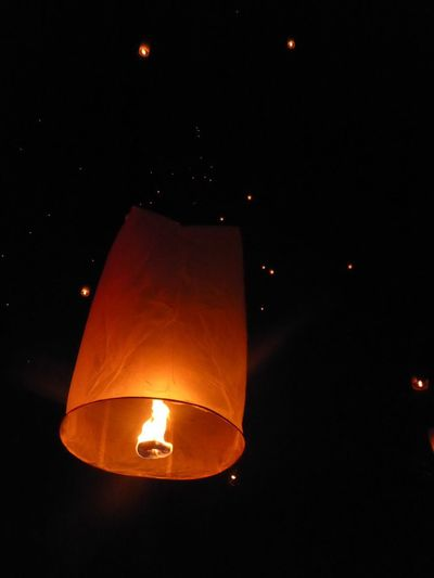 Yee Peng Festival Sky Lantern Illuminated Night Lighting Equipment Glowing Orange Color Flame No People Low Angle View