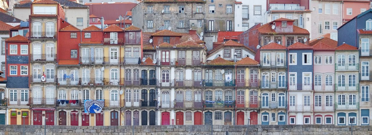 Porto riverside houses Building Exterior Architecture Built Structure Residential District Full Frame Building Window Backgrounds City Day In A Row Outdoors Pattern Side By Side Multi Colored Apartment House No People Repetition The Street Photographer - 2018 EyeEm Awards The Traveler - 2018 EyeEm Awards
