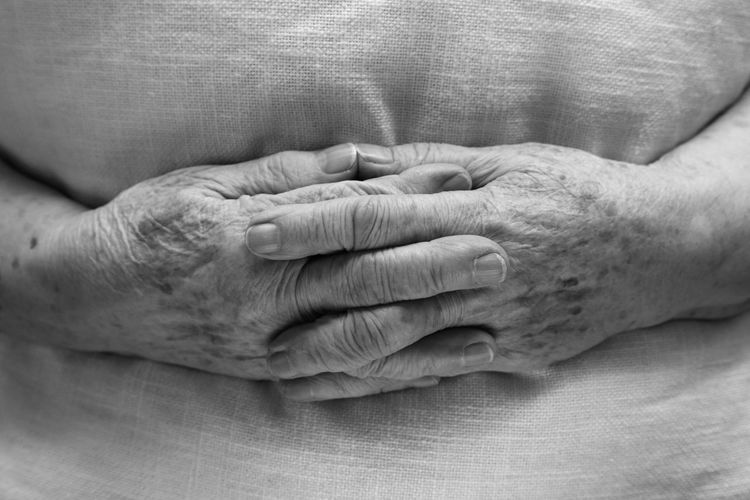 Hands of an old woman in a bed Adult Bonding Close-up Day Friendship Grandmother Healthcare And Medicine Human Body Part Human Finger Human Hand Human Skin Indoors  Lifestyles People Real People Senior Adult Senior Women Togetherness Two People Unity Women Wrinkled