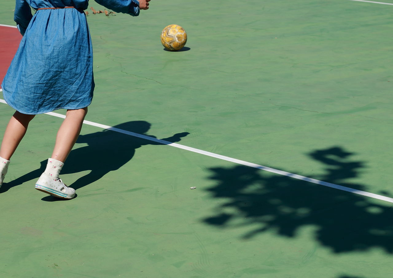 Low Section Of Woman Playing Soccer