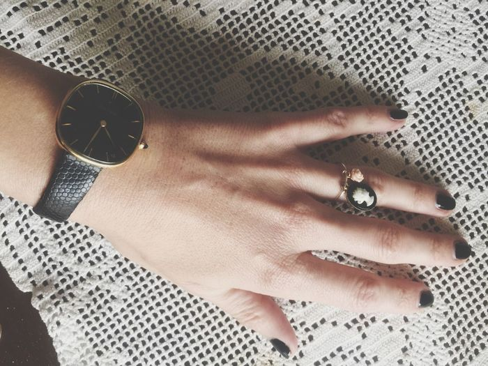 Cropped Image Of Woman Wearing Wristwatch And Ring