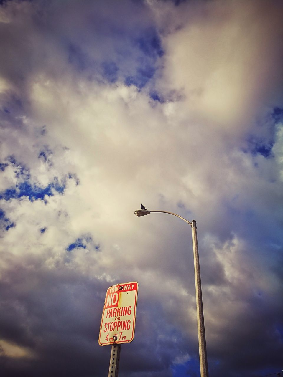 low angle view, sky, communication, cloud - sky, no people, street light, day, outdoors, road sign