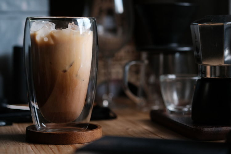 Ice coffee in morning , latte coffee on wood table
