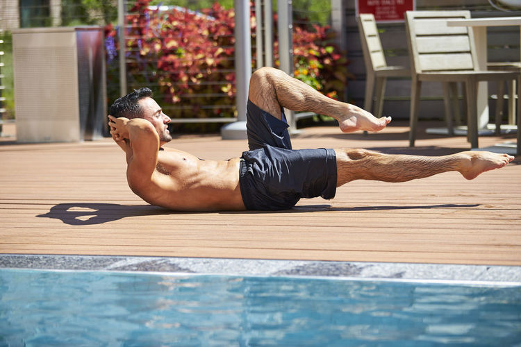 Midsection of man relaxing outdoors