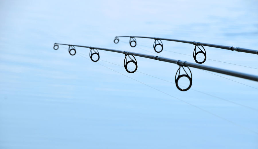 Low Angle View Of Fishing Rods Against Sky