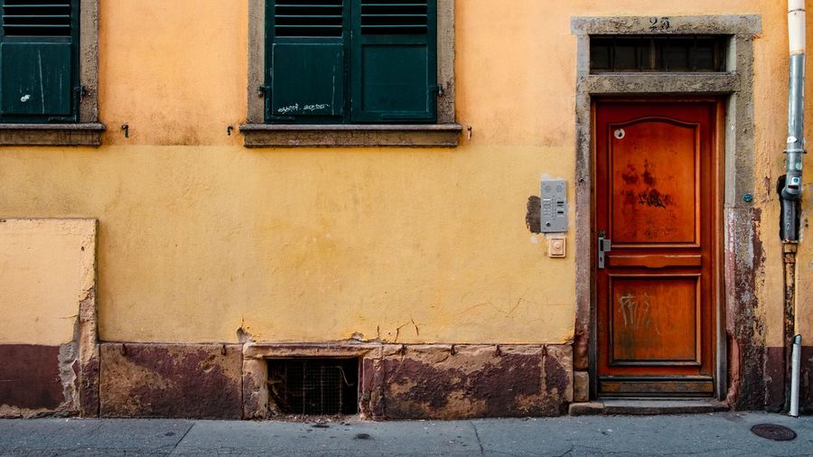 Urban Perspectives Street Photography Sidewalk The Devil's In The Detail Architectural Detail Building Exterior Architecture Built Structure Entrance Door Building Closed House Window Day No People Residential District Safety Security Old Protection Wall - Building Feature Wood - Material Front Door Window Frame The Architect - 2019 EyeEm Awards The Street Photographer - 2019 EyeEm Awards My Best Photo