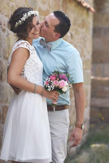 Couple holding flower bouquet