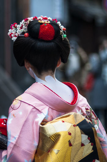 Rear View Of Girl Wearing Kimono Outdoors