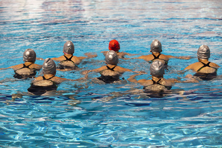 Rear view of swimmers in pool