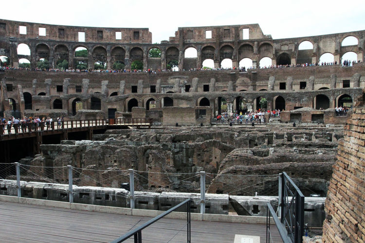 Amphitheater Ancient Ancient Civilization Arch Archaeology Arched Architecture Arts Culture And Entertainment Building Exterior Built Structure Colosseum Day History Incidental People Nature Old Ruin Railing Ruined Sky The Past Tourism Travel Travel Destinations
