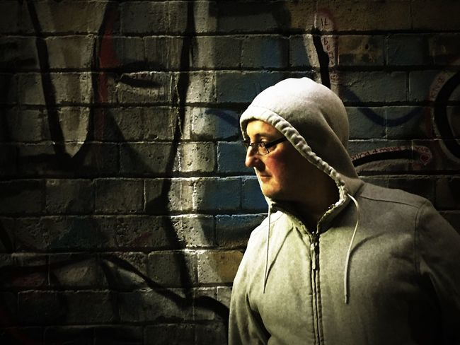 One Person Standing Men Real People Hoodie Night Graffiti Graffiti Wall Portrait Filter Filtered Image Young Adult Outside City Life City At Night Urban Urban Lifestyle Urban Photography Portrait Photography Outdoor Portrait Graffiti & Streetart HOODIES Man Night Photography Nightphotography Postcode Postcards