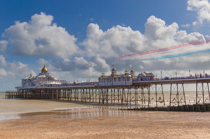 Eastbourne Pier and Red Arrows Airshow Coast Europe Trip Beach Seaside Red Arrows England Sussex Airbourne Pier Eastbourne Seaside Sky Cloud - Sky Architecture Beach Built Structure Nature Day Travel Tourism Travel Destinations Vapor Trail Air Vehicle No People Water