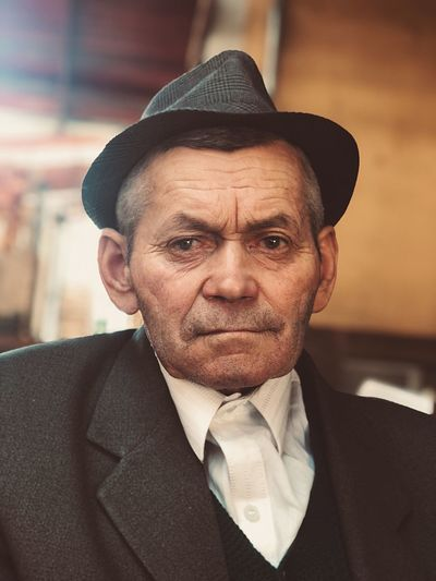 Feelings ShotOnIphone Sad Alone Sadness Loneliness Old Man Portrait Portrait Males  Men One Person Headshot Clothing Adult Suit Lifestyles Real People Senior Adult Senior Men Business Mature Men Businessman Hat Menswear Contemplation Looking At Camera Front View