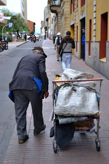 Bogotá Building Exterior Casual City City Life Colors Day Full Length Homelessness  Lifestyles Men Mode Of Transport Outdoors People And Places People And Places. Person Rear View Road Street Transportation