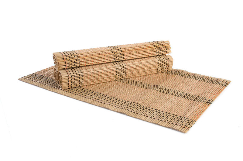 High angle view of bamboo place mats on white background