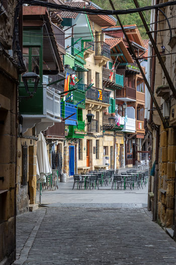 Outdoor seating and historic buildings in Pasai Donibane, Spain Architecture Basque Country Country Donibane Euskadi Façade Pasai Donibane - Euskalherria Pasajes Passenger SPAIN San Sebastian Balconies Balcony Building City Colorful Guipuzcoa Historic House Multicolored Outdoors Pasaia Residential District Town Village