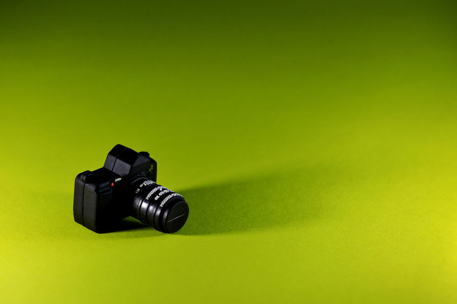 Black camera - USB flash on yellow background. Camera Flash Memory USB Flash Drive Backround Black Black Color Camera - Photographic Equipment Close-up Computer Data Gift Indoors  Indoors  No People Photo Camera Photography Themes Storage Studio Shot Technology Yellow