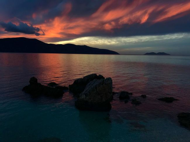 Albania #Radhime Radhime Sunset Sea Scenics Nature Beauty In Nature Sky Water Tranquil Scene Tranquility Mountain Cloud - Sky Rock - Object Silhouette No People Outdoors Horizon Over Water Day