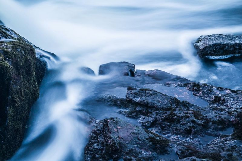 Blurred motion of rocks and sea