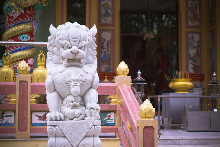 Statue in temple outside building