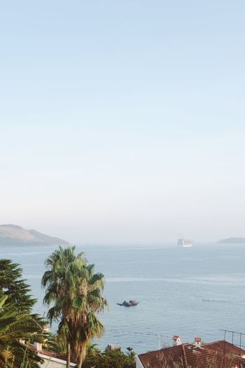 Scenic view of bay against clear sky