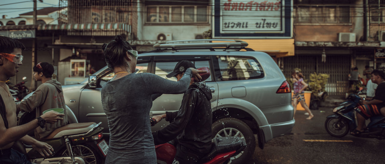 Songkran Festival Thailand Architecture Building Exterior Built Structure Car City Day Focus On Foreground Group Of People Land Vehicle Leisure Activity Lifestyles Men Mode Of Transportation Motor Vehicle Outdoors People Real People Street Transportation Travel Women