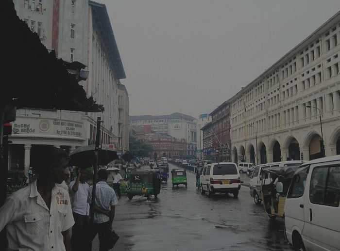 Pettha Colombo Street City Wet City Life People Car City Street Extreme Weather Architecture Land Vehicle Outdoors Adult Building Exterior Day Adults Only Sky Only Men Riot