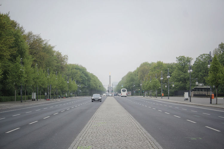 Architecture Berlin Built Structure Capital Cities  Car City Day Diminishing Perspective Germany Land Vehicle Moody Sky No People Outdoors Road Siegessäule  Sky Straße Des 17. Juni Street The Way Forward Transportation Travel Tree Your Ticket To Europe Berlin Love