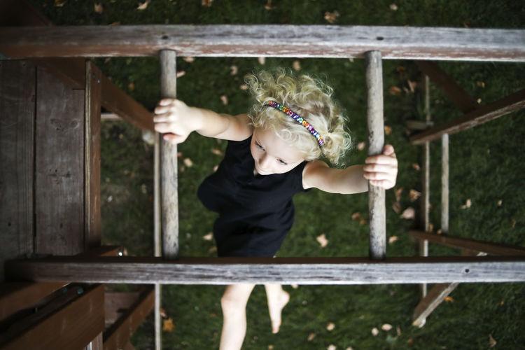 Full length of woman holding railing