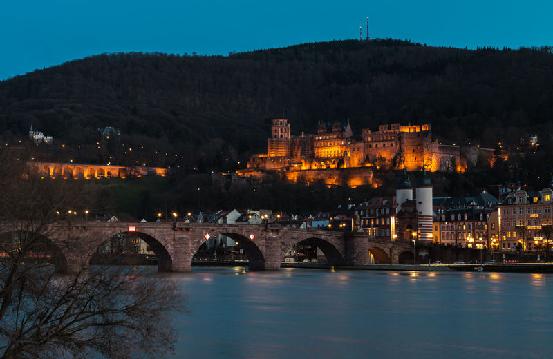Heidelberg Castle and River Neckar at Dusk Architecture Bridge - Man Made Structure Building Exterior Built Structure Castle City Citycapes Connection Dusk Germany Heidelberg History Illuminated Mountain Nature Night No People Old Bridge Outdoors River Riverside Sky Travel Destinations Tree Water
